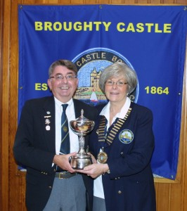 Brian receives trophy from Club President Jennifer Stewart at recent BCBC Awards Dinner